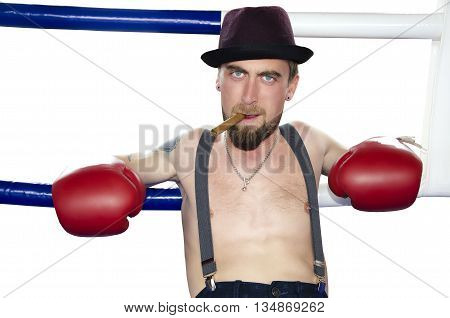 Portrait of angry boxer with cigar on a boxer ring