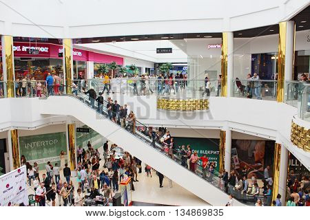 Chernihiv / Ukraine. 09 May 2016:  people going for shopping on the escalator in the supermarket in Chernihiv. 09 May 2016 in Chernihiv / Ukraine.