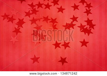 Red Christmas stripes background with star shapes