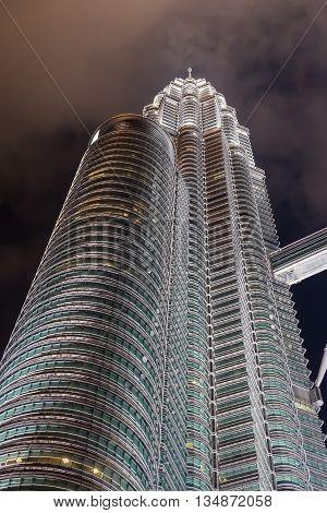 KUALA LUMPUR MALAYSIA - FEBRUARY 29: Night scene of the one of Petronas twin towers on February 29 2016 in Kuala Lumpur Malaysia.