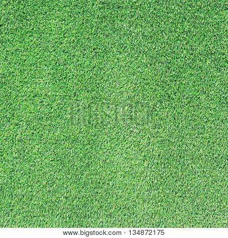 Green artificial grass field texture for background,