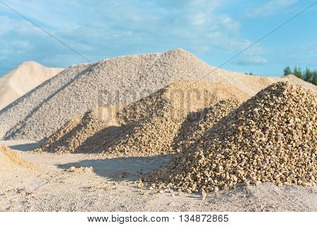 pile of limestone quarry on background of blue sky