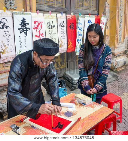 HAI DUONG, VIETNAM, February 11, 2016 Mr. map, calligraphy. At the temple, New Year's Day. Interesting pun drought, Vietnam Favorite people