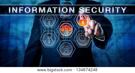 Corporate manager is pushing INFORMATION SECURITY on an interactive touch screen monitor. Information technology concept for data security computer security crime prevention and access control.
