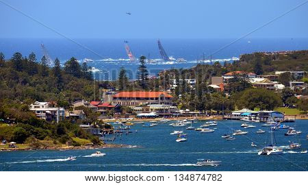 Sydney, Australia - December 26, 2014. Comanche is leading after The Gap. The Sydney to Hobart Yacht Race is an annual event, starting in Sydney on Boxing Day and finishing in Hobart.