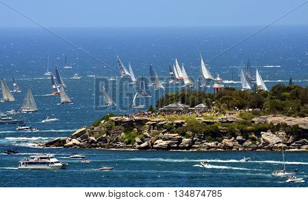 Sydney, Australia - December 26, 2014. Spectators are watching the race from South Head. The Sydney to Hobart Yacht Race is an annual event, starting in Sydney on Boxing Day and finishing in Hobart.