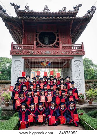 HA NOI, VIET NAM, April 30, 2016: Ha Noi bachelor groups, photographic memories. In historical culture, Van Mieu Quoc Tu Giam. center of Ha Noi, Vietnam. Day closing ceremony