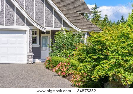 Fragment of a very neat and colorful home with gorgeous outdoor landscape in suburbs of Vancouver, Canada.