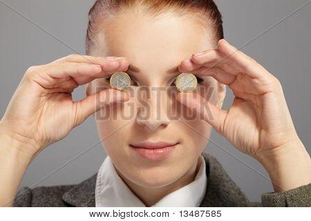 portrait of pretty businesswoman with money