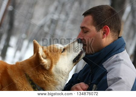 Man and his dog share piece of cracker