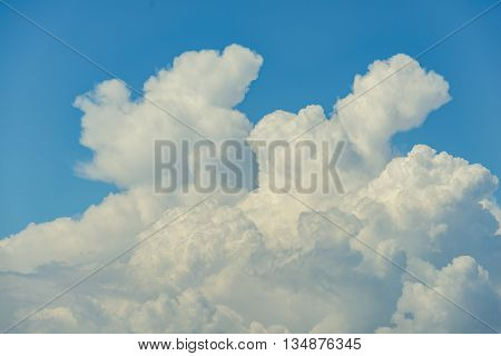 Cumulus clouds against the blue sky in summer