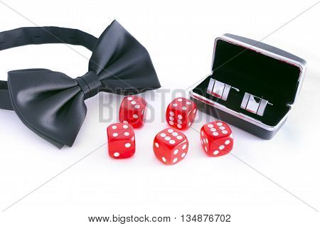 Cufflinks bowtie and red dices isolated on white background. Gentlemen suite for casino.