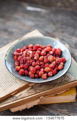Fresh organic wild strawberries on a plate