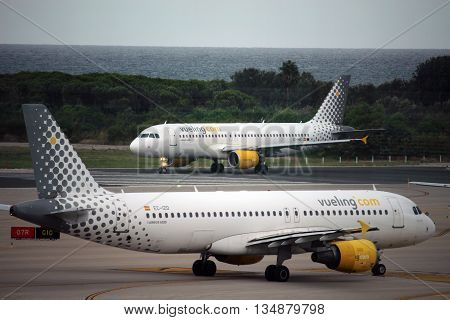 BARCELONA/SPAIN - 29 SEPTEMBER 2015: Two Vueling Airbuses ready to take off from the runway of El Prat airport