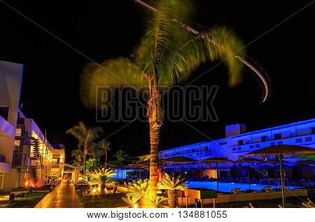 trajectory of the aircraft lights on night modern hotel in Rhodes Greece