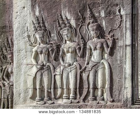 stone-carved figures at a temple complex named Angkor Wat in Cambodia