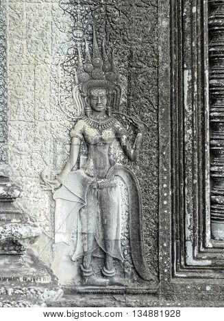 stone relief and sculpture at a temple complex named Angkor Wat in Cambodia