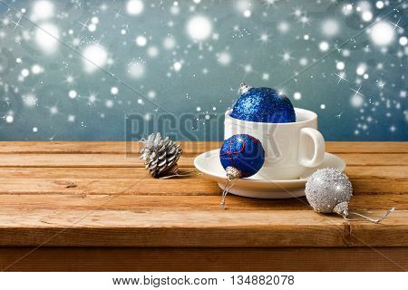 Christmas still life with ornaments and coffee cup