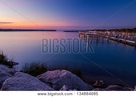 Morning Sunrise Over Michigan Harbor. Dawn on a Lake Huron harbor and marina in Michigan.
