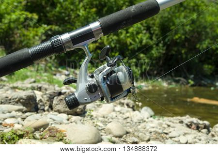 Plastic fishing tackle on nature background closeup