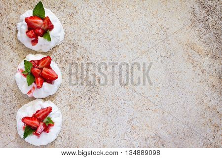 Pavlova Meringue Cake With Fresh Strawberries On Brown Stone Background, Top View. Space For Your Te