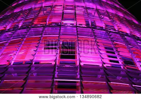 BARCELONA/SPAIN - March 8, 2015: Detail of the Agbar tower colored in pink with LED illumination to celebrate the International Women's Day