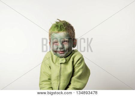 Tricky little boy dressed as zombie on Hallowen