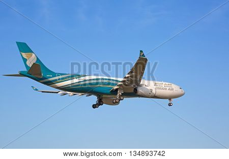 ZURICH - JULY 18: A-330 Oman Air landing in Zurich airport after long haul flight on July 18, 2015 in Zurich, Switzerland. Zurich airport is home port for Swiss Air and one of european hubs.