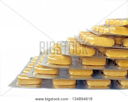 Yellow medication blisters stacked in stairs shape