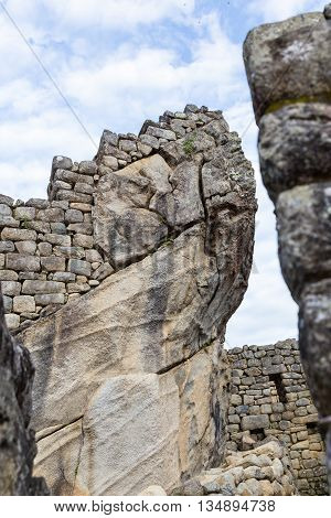 Inca construction at Machu Pichu using existing stone with walls built on top