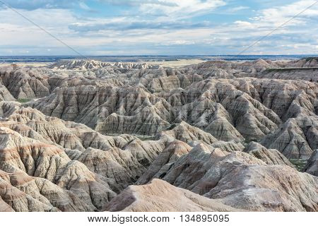 Erosion has revealed stripes of brown rock in sandstone ridges of the Badlands.