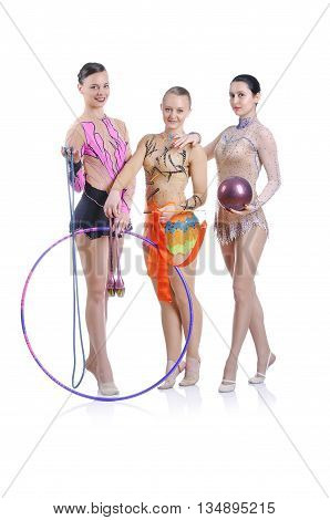 Portrait of three beautiful young rhytmic gymnasts posing