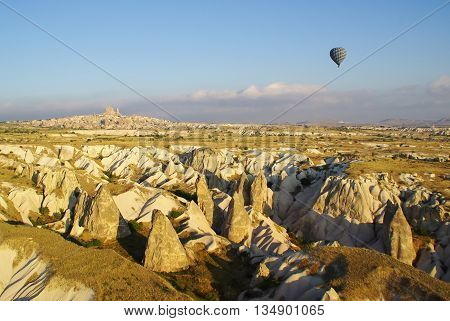 Solitary balloon over the geologic formations of Cappadocia