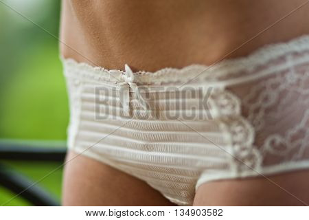 Body Beautiful athletic woman in white lingerie