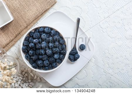 Juicy and fresh blueberries on the table. Bilberry on the white table background. Blueberry antioxidant. Concept for healthy eating and nutrition. up view