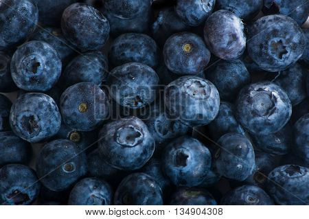Juicy and fresh blueberries on the table. Bilberry on the white table background. Blueberry antioxidant. Concept for healthy eating and nutrition. close-up