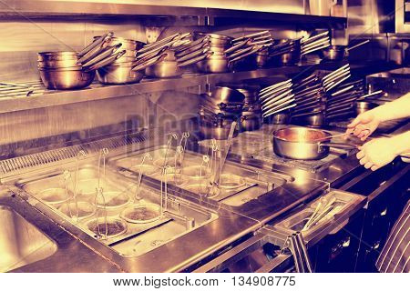 Typical kitchen of a restaurant shot in operation, toned