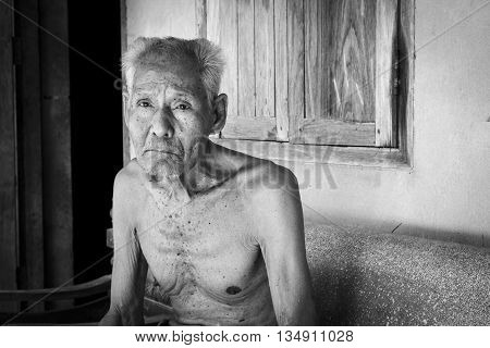 Elderly man sitting alone on the chair