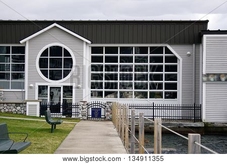 HARBOR SPRINGS, MICHIGAN / UNITED STATES - DECEMBER 24, 2015: The Boathouse Club, in the Walstrom Marine Boathouse next to Zorn Park, is open to members and guests only.