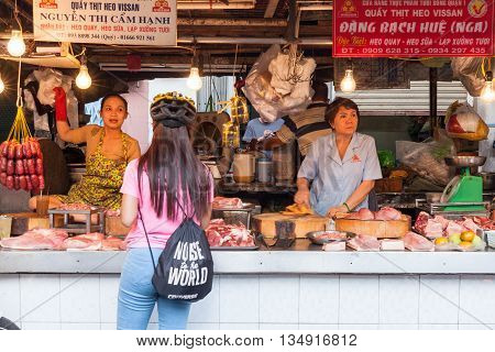 HO CHI MINH CITY VIETNAM - FEBRUARY 07: Women are selling meat at the wet market on February 07 2016 in Ho Chi Minh City Vietnam.