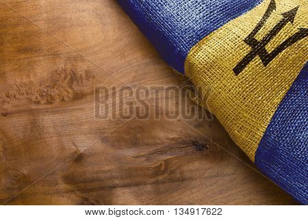State Barbados flag on a wooden background.