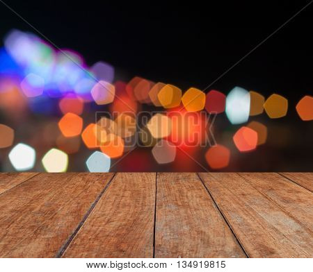 Perspective wooden with abstract blurred lights in Loy Krathong festival
