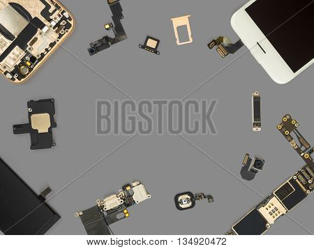 Flat lay (Top view) of smart phone components isolate on gray background with copy space