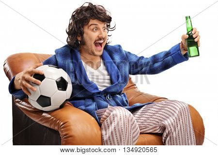 Excited football fan watching a game on TV and drinking beer isolated on white background