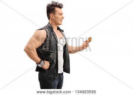 Profile shot of a punk rocker holding a chocolate chip cookie isolated on white background