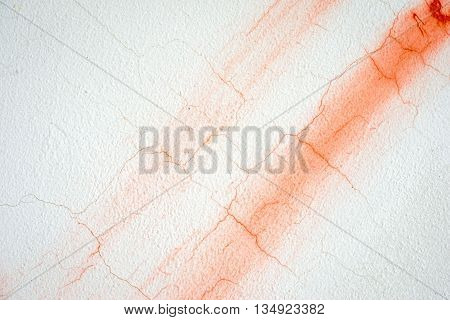 Cracked Painted Red And White Concrete Putty Wall With Diagonal Stripe