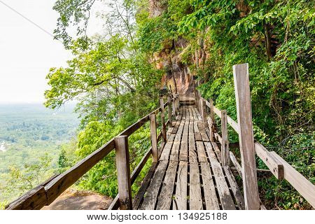Wooden walkway on sandstone mountains at Phu thok temple Sri Wilai district Bueng Kan Thailand.