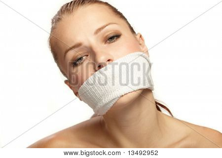 Cute young woman with white band on the mouth