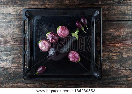 Wet Eggplants In Frying Pan Top View