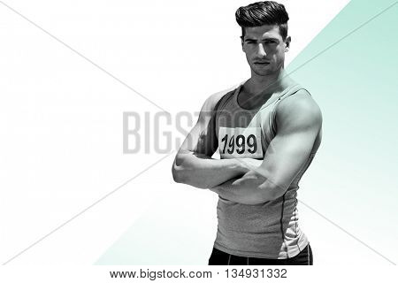 Portrait of handsome sportsman is posing with crossed arms against different colors